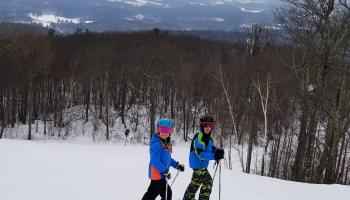 Two people on a ski mountain