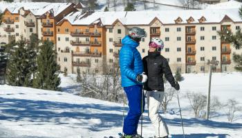 skiers outside their hotel