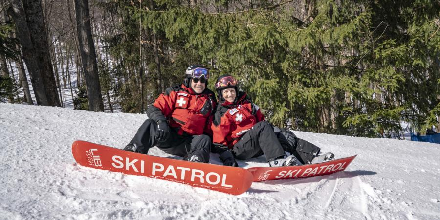 ski patrol sitting on the mountain